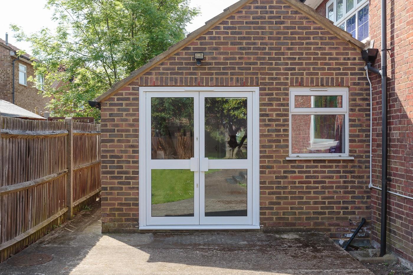 Commercial window & door services - Church door replacement in Surbiton